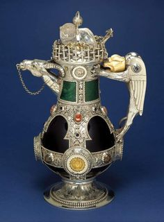 """1865-1866  Decanter by William Burgess at the Victoria and Albert Museum, London - Burgess designed several decanters similar to this one. These included two for use in his own home, Tower House in Kensington, London, as shown in contemporary photographs. Burges looked to the arts of China, Assyria, ancient Greece and Rome, and medieval Europe as inspiration for this design."""""""