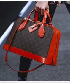LV Spring 2015 Love the red  The Dora Monogram PM with lipstick red leather.