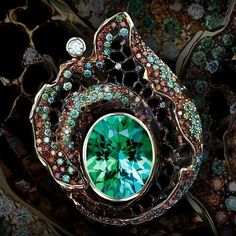 @jewellerytheatre Get in touch with your primal side with our High Jewellery Ring. 125 cognac diamonds, 114 green diamonds and 23 diamonds in a seductive swirl around a 5.30 carats of tourmaline, all set in yellow gold, bring together the elemental and sophisticated in one beautiful piece.
