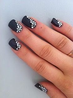 I have never painted my nails black (aside from Halloween,) but now I might! Black and White Polka dot nails #FunNailArt