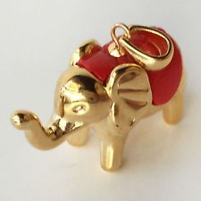 Gold plated puffy 3D elephant shape with red cover on back dangling pe... Lot 92