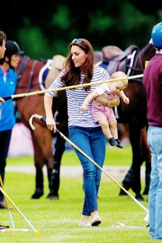 Prince George and his mum cheer on his daddy at a polo match