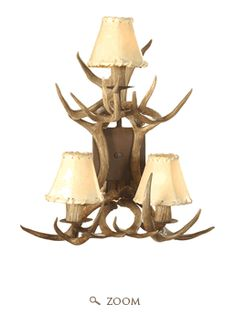 A couple of years ago the fabulous magazine, Western Interiors, featured Country & Western singer, Ronnie Dunn's, Santa Fe home . Antler Lights, Antler Chandelier, Chandeliers, Santa Fe Home, Country Western Singers, Wall Lights, Ceiling Lights, Wall Sconces, Wall Lamps
