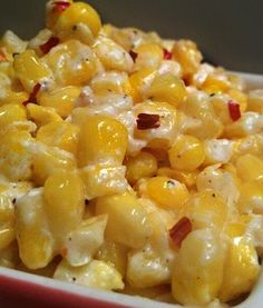 Delicious Cream Cheese Corn  1 lb. corn fresh or thawed  1 Tbls. Butter  3 oz. Cream Cheese  Red Pepper Flakes  Pepper  Combine corn, butter, cream cheese. Microwave @ 2 min intervals. When heated through & cream cheese is melted season w/ pepper & red pepper flakes.