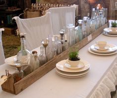 DIY wooden crate table runner filled with vintage bottles. Wooden Crates Table, Diy Wooden Crate, Crate Table, A Table, Dinner Table, Wood Table, Antique Bottles, Vintage Perfume Bottles, Bottles And Jars