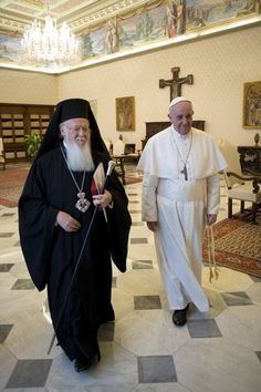 Pope Francis walks with Ecumenical Patriarch Bartholomew from Istanbul during a private meeting at the Vatican