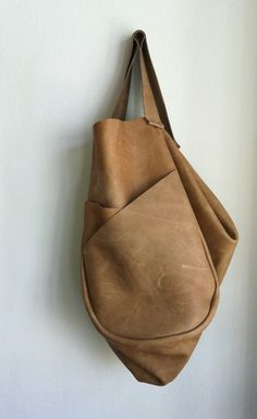 LOVE POCKET DETAIL. Image of Medium Tan Dolores Bag