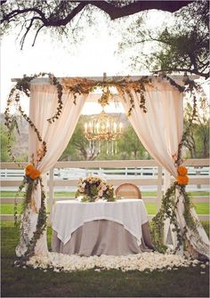 When your wedding reception is outside, good lighting might be limited once the sun goes down. Vintage weddings often hang chandeliers from sturdy tree branches or over arches located around the reception. It illuminates the space and stays with your theme.