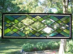 stained glass window.  Do these as transom windows above living room, dining room, and entry.
