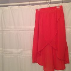 High-low skirt Orangey/red high-low skirt from Charlotte Russe. Only worn once. Elastic waist in the back Charlotte Russe Skirts High Low