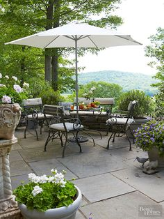Antique garden furniture and accessories bring sophisticated substance to century-old and brand-new patios alike. Look for garden relics at estate sales, flea markets, and antique shows specializing in vintage garden gear. Designed after French antiques, these reproduction pieces perfectly suit the homeowner's love of European style, while supplying modern function on this stone-paved hilltop patio.