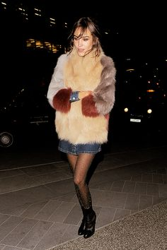 Alexa Chung #Denim #Tights | @andwhatelse Bianca Jagger, Charlotte Rampling, Twiggy, Fur Coat Outfit, Pink Fur Coat, Alexa Chung Style, Winter Chic, Ag Jeans, Work Looks