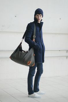 This combo of a navy overcoat and navy skinny jeans makes for the ultimate laid-back getup for today's gent. Switch up your look by slipping into white low top sneakers. Navy Overcoat, Navy Coat, Looks Cool, Men Looks, Fashion Moda, Mens Fashion, Style Fashion, Canvas Duffle Bag, Denim Skinny Jeans