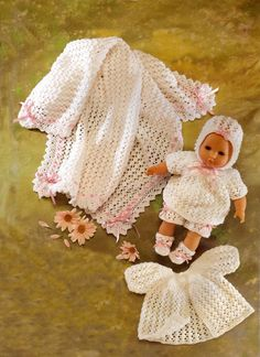 Sweet Layette to knit for a 36 cm (14.5 inch) doll.  Instructions are to make  a dress, knickers, bootees, coat, bonnet shawl and pram cover. Pattern available on Ebay.