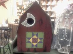 Hand-painted miniature Ohio Star quilt block on birdhouse, reclaimed from antique barn board and tin roofing from Tin Treasures by Orchard Canyon Heirlooms