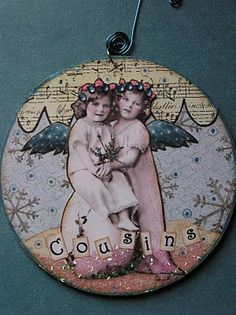 altered CD ornament.  Cover a CD with gel medium and then decorative papers on the front and back and added a vintage picture, glitter, marker, gel pen and rhinestones.