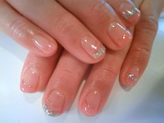 neutral nail with silver glitter tips