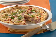 With tons of taste but little fat, this light and luscious quiche is the perfect choice when losing a little weight is on your mind.  Serve with fresh