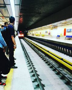 The train is coming... #city #capital #here #sky #photo #streetphotography #asphalt #تهران #metal #human #persian #iran #irantoday #myday #station #long #yellow #nofilter #green #sun #shadow #daylight #miromid #tehran #metro