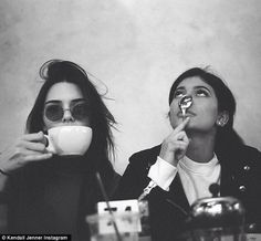 Holiday break: Kendall Jenner, 20, took a moment to post a picture of her and sister Kylie, 18, along with a cryptic message In the black and white snap, Kendall is drinking out of a tea cup, and most of her visage is obscured by some dark circle lens shades. Her dark locks look quite frazzled. Sister Kylie seems to be looking at something above the pair, and playfully covers her nose with a spoon.