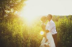 groom kissing his bride (photo by michelle gardella via emmaline bride)