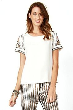 The Sugarlips Cool Jewels Top is a cool white top with awesome details on the sleeves. Features beading, cutouts, and sequins on sleeves. Exposed zipper closure on back. Price : $70.00 #MyLuluCloset #Sugarlips #NewArrivals