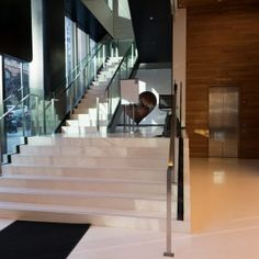 LinkedIn Office - Interior Stairway - A polished concrete floor stairway with glass balustrade.