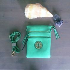 Celtic Circle  Messenger Bag in Mint Zipper top closure Textured faux leather Rear zipper pocket Front zipper pockets Inside lining with zipper pocket Comes with 51 inch adjustable strap 7 (W) x 9 (H) inches.  Any questions just ask! Second Star Sisters Bags Crossbody Bags