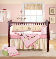 Sophisticated yet soft, the Love Bird baby bedding collection by Lucky Duck Studios will enchant all little girls. Embroidered birds, leaves and flowers embellish the lovely pink and yellow tones of this delightful crib set, which includes comforter, crib sheet, and dust ruffle.