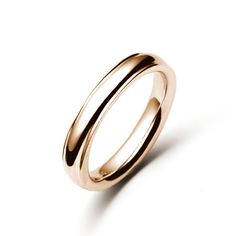 The Ridgeback, shown here in rose gold, is a classic men's band. It is a 4mm wide comfort fit.