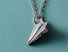 Paper airplane necklace. DARK HARRY FEELS. (But he legit has a paper airplane necklace)