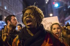 A woman shouts slogans against police brutality while marching on the streets of Manhattan. REUTERS/Elizabeth Shafiroff