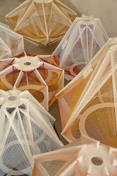 Etherial sputnik lamps by Julie Lansom. Colored string and wood lighting. #pendantlighting #light #lighting