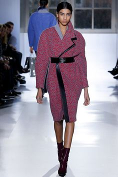 Love these a-symmetrical coats - the black leather line looks cool and gives a feeling of movement - Balenciaga Fall 2014