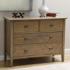Decorate your bedroom decor in luxurious style with the Cooper Provence 4-drawer dresser. This exceptional piece highlights a solid wood construction, two short and two long drawers, and tapered leg styling.