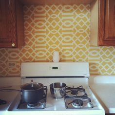 Who decided that laminate faux-granite was attractive OR functional? Where is my subway tile? The fix: This DIY fabric backsplash from The Golden Girl is easy, cheap, and endlessly customizable—not to mention it holds up surprisingly well thanks to the fabric stiffener used to adhere the fabric to the wall. You can also do the same thing with contact paper. We love Max & Fodder's temporary silver kitchen backsplash.     - HouseBeautiful.com