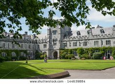CORK, IRELAND - JUNE 29: University College Cork (UCC) quad with students present on June 29, 2013 in Cork, Ireland.  The university was founded in 1845. - stock photo