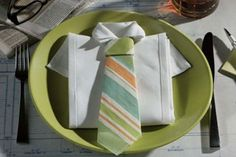 shirt-and-tie-napkin-fold. This web page is in another language, but the video tutorial is Better Homes and gardens and in English, not that it matters, you can see how it's done.