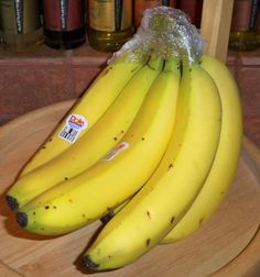 Keep your bananas from turning brown - wrap tops with plastic, keeps them up to a week longer!