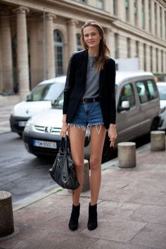 STREET STYLE SPRING 2013: PARIS FASHION WEEK - Irina Kulikova shows off her legs for days in denim cut offs and black booties. | @andwhatelse