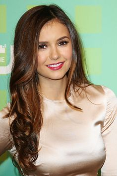 Dobrev's contouring brings a golden radiance to her features, allowing light to reflect beautifully.