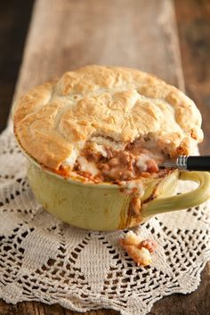 Paula Deen Shepherd's Pie:  Ingredients:  1 1/2 cup mixed vegetables or niblet corn, prepared   2   8-ounce cans tomato sauce   1   small onion   1 1/2 lb ground meat   1/2 cup sour cream   12 tablespoon butter   1 1/2 cup milk   8-10   medium red new potatoes   2 cup instant biscuit mix, prepared   Salt and Pepper to taste