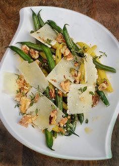 Scrumptious green & yellow bean salad...fresh from the farmers market...lemon honey,shallot vinaigrette, toasted walnuts, shavings of Pecorino Romano, scattered with fresh thyme leaves!