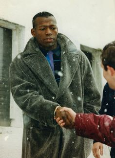 Tino Asprilla arrives at Newcastle United suitably dressed for the cold North.