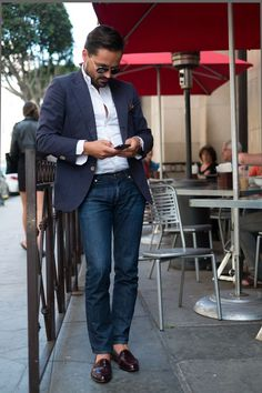 Shop this look for $165:  http://lookastic.com/men/looks/jeans-and-loafers-and-blazer-and-longsleeve-shirt-and-pocket-square/1521  — Navy Jeans  — Burgundy Leather Loafers  — Navy Blazer  — White Longsleeve Shirt  — Brown Pocket Square
