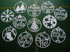 These 12 circular Christmas templates can be printed onto paper and cut out with a craft knife to create beautiful decorations for the tree and
