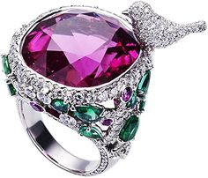Piaget Limelight rubellite Garden Party ring in 18K white gold, set with one pink cushion-cut rubellite, 16 pear-shaped emeralds, 8 pink brilliant-cut sapphires, and 359 brilliant-cut diamonds.