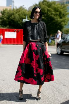 Eva Chen paired her girlie-cool Tibi skirt with a perforated jacket.  #streetstyle