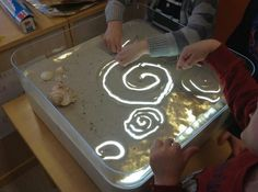 """Is a Light Box DIY light box with sand - plastic tub with light inside. fill the cover with sand & have fun ("""",)DIY light box with sand - plastic tub with light inside. fill the cover with sand & have fun ("""",) Sensory Activities, Sensory Play, Learning Activities, Preschool Activities, Reggio Emilia, Art For Kids, Crafts For Kids, Licht Box, Light Board"""