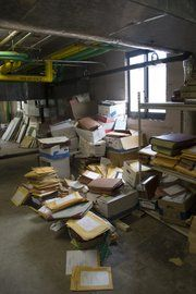 Boxes, folders and papers are left in a sloppy pile in a dirty file room. Records Management, Boxes, Room, Bedroom, Crates, Rooms, Box, Cases, Rum